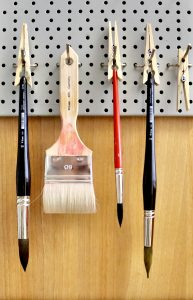 Hanging artist brushes drying