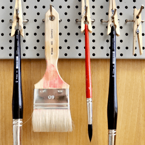 Artist brushes hanging to dry after washing