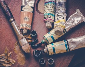 Tubes with oil paint and artist brush