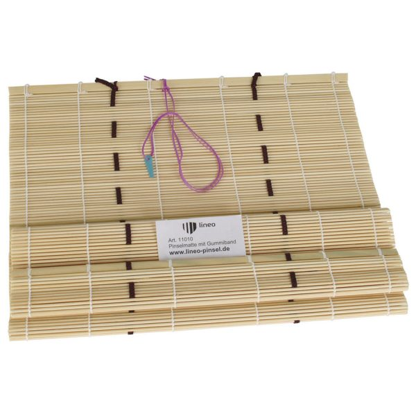lineo brush mat with rubber string for storing and transporting artist brushes.
