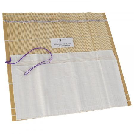 lineo brush mat with rubber string and cotton bag for storage and transportation of artist brushes.